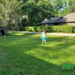 father and daugher playing ball in the yard