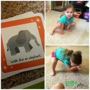 Toddler playing move and grove game
