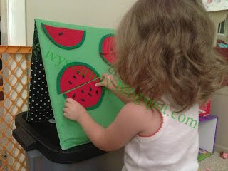 toddler playing with felt watermelon seed activity www.sahmplus.com