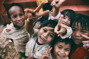 volunteer with children; poor happy children