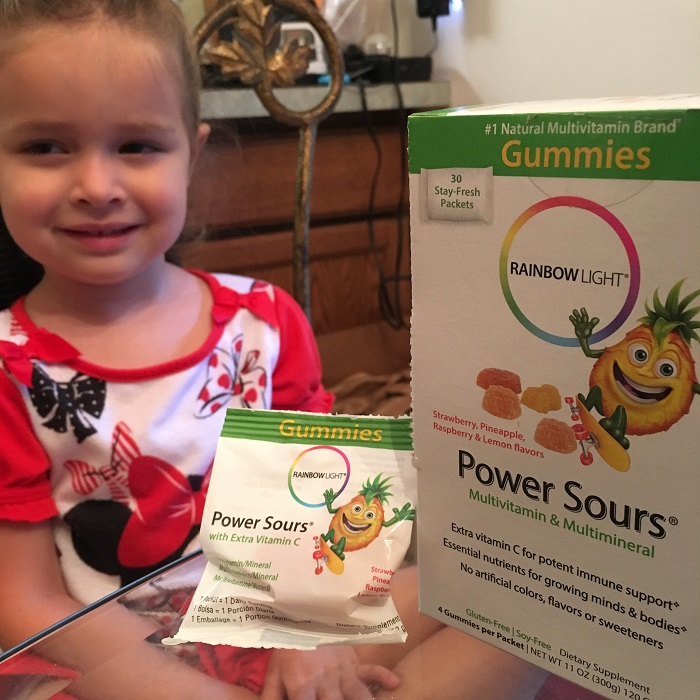 Tired and sick kid boosting her immune system with Rainbow Light Power Sours® Multivitamin gummies | www.sahmplus.com