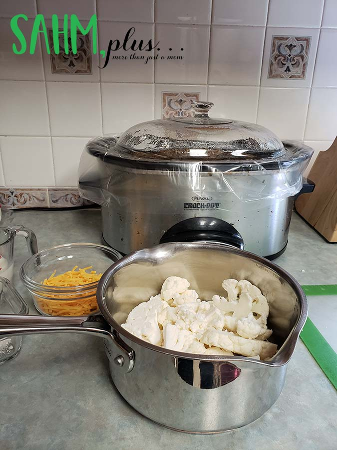 Preparing dinner for the family - pot with cauliflower, crock pot, other food   sahmplus.com