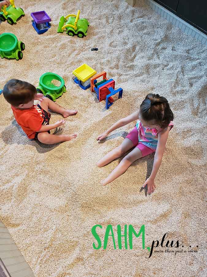 Kids playing in rubber sand at The Glazer Children's Museum in Tampa