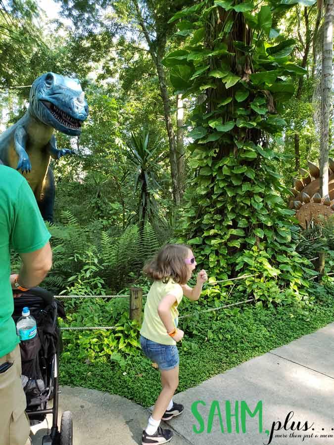 Pretending to run from a dinosaur at Dinosaur World Plant City | sahmplus.com