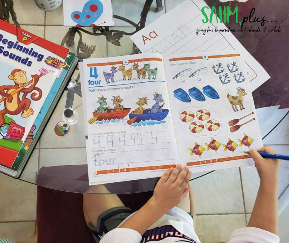 child working on school zone preschool workbook