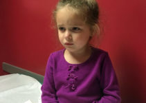 Sick girl at pediatrician's office