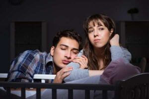tired parents wondering how long baby sleep regression lasts