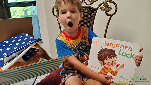 child surprised by new books from BookRoo, getting benefits of reading delivered to home