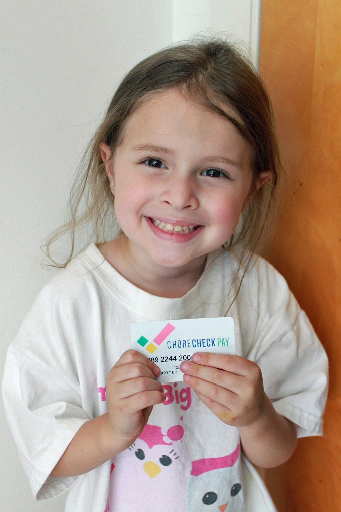 Child with chore check pay card .... managing chores and allowance electronically with Chore Check Pay www.sahmplus.com