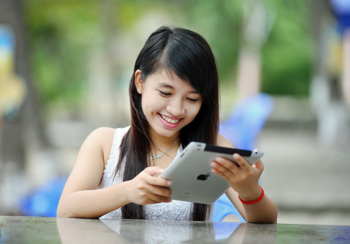 Teen with Ipad; parenting in the age of digital technology