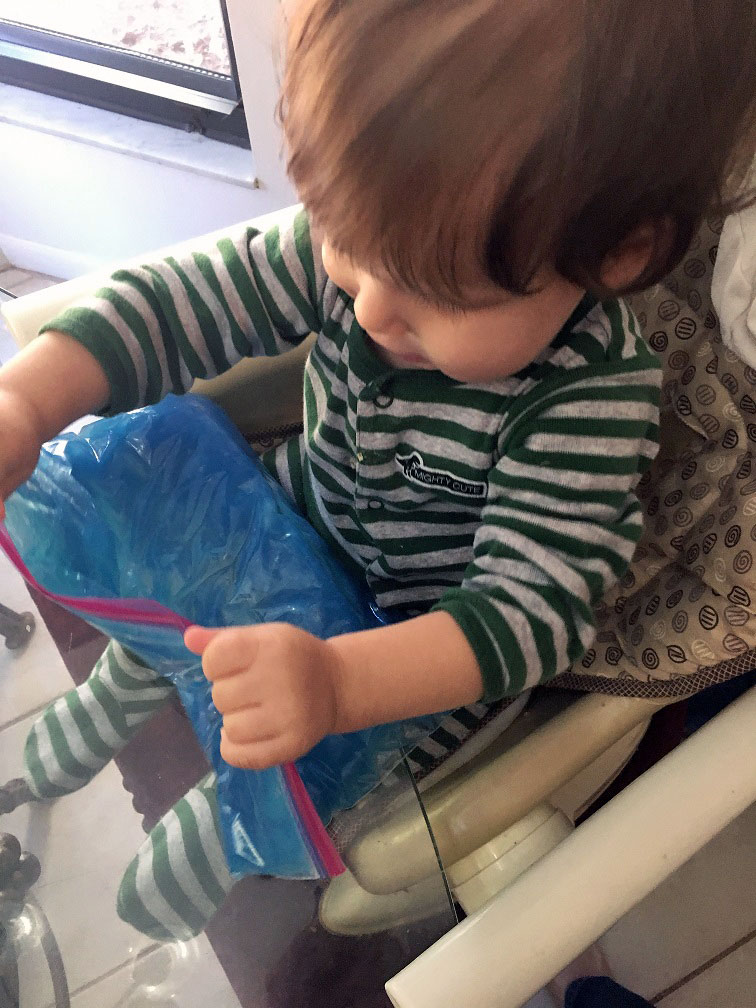Toddler playing with his new toddler squishy bag