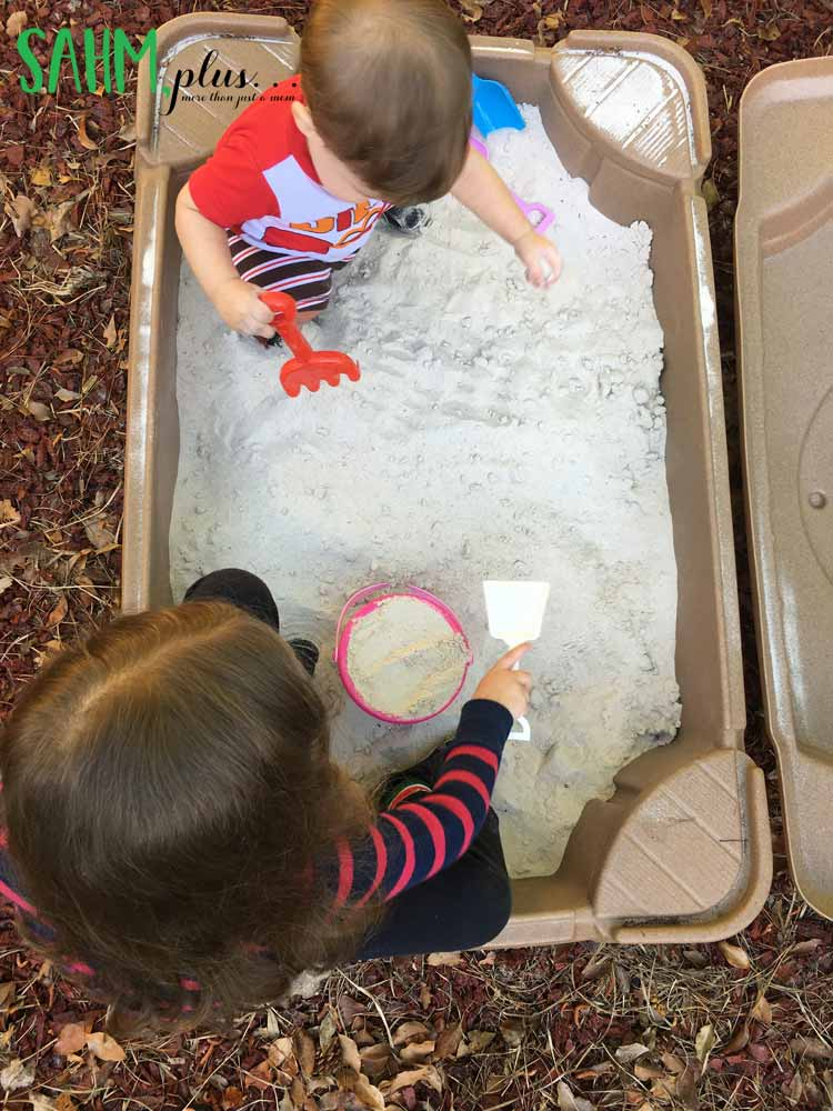 Digging in the sandbox is a great backyard activity for toddlers