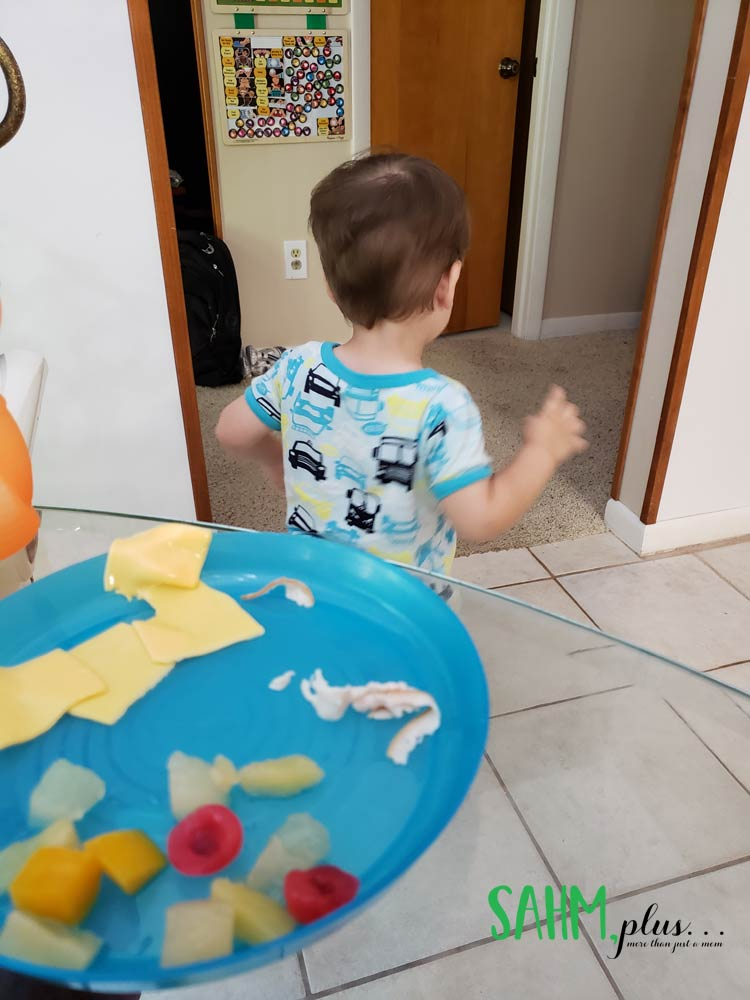 My toddler mealtime battle hack - letting him eat on the run   sahmplus.com
