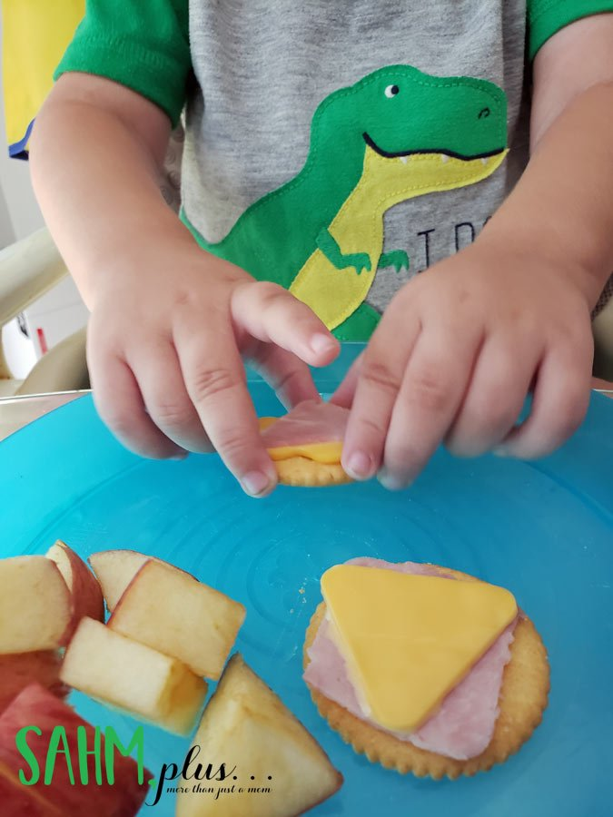 shaped ham and cheese on crackers makes a fun and easy toddler snack idea