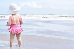toddler girl on the beach. Is a Disney Cruise with a toddler a good idea?
