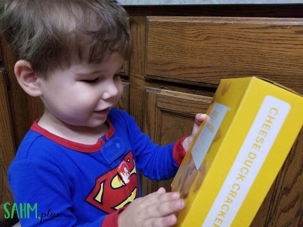toddler with brandless organic cheese duck crackers non-gmo snack