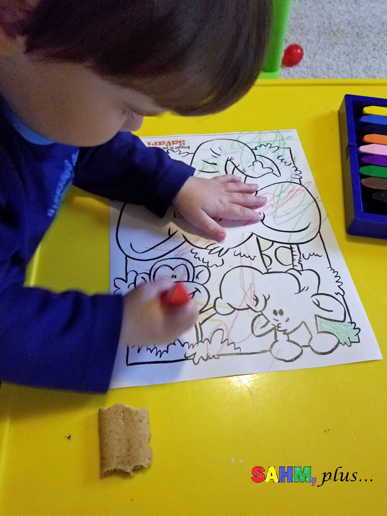 Toddler coloring a jungle page - a sponsored post on behalf of WildBrain | www.sahmplus.com