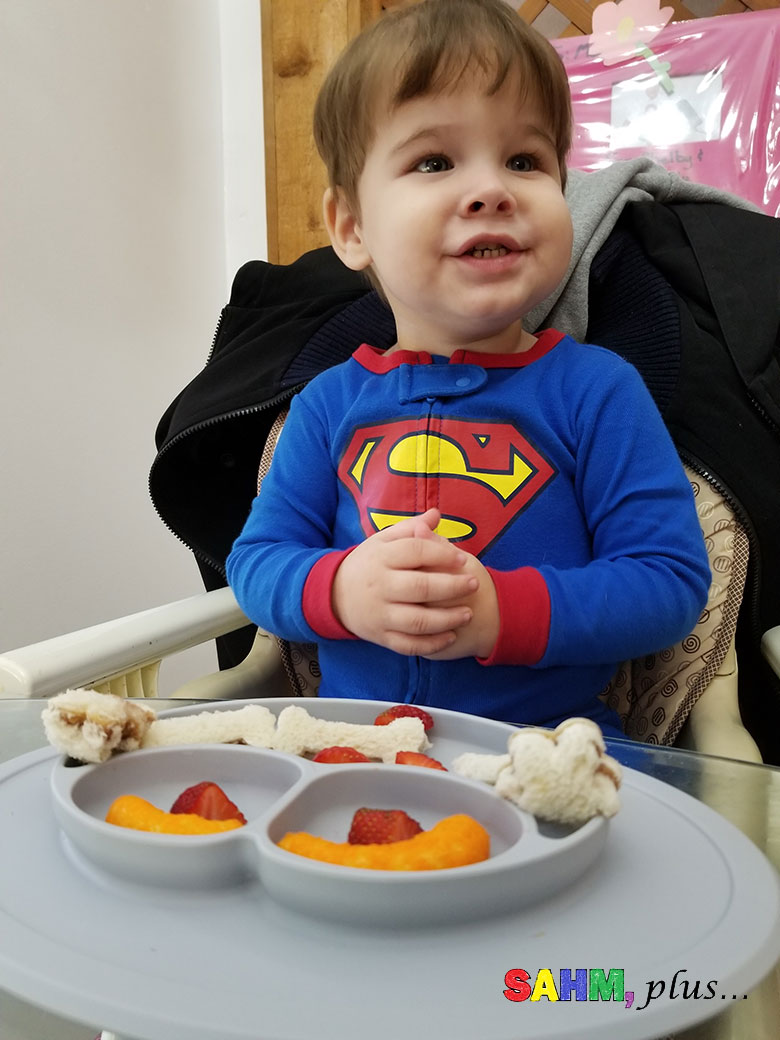 Toddler eating his cut food after mom used FunBites food cutters for kids   www.sahmplus.com