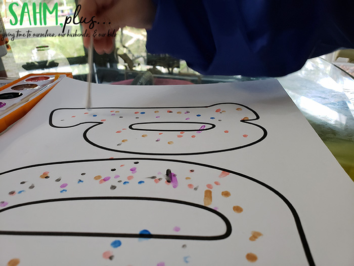 Painting dots with a Q-top on the letter Dd from The Preschool Box