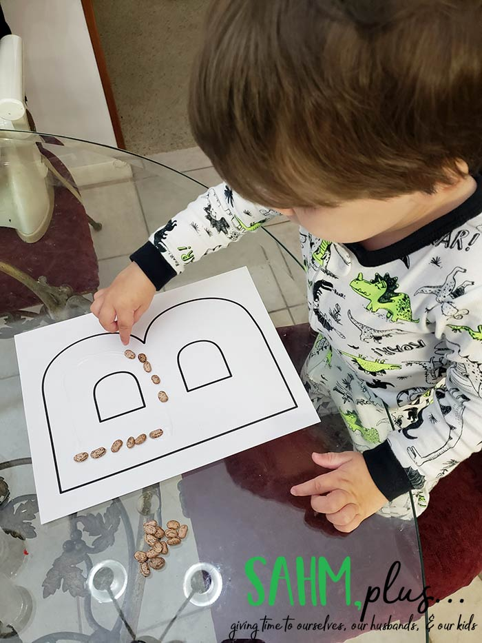 3 year old doing letter B bean craft from The Preschool Box