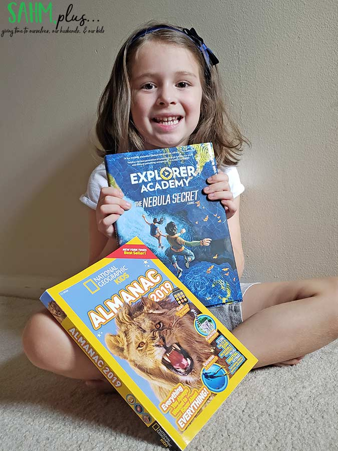 girl with National Geographic Kids books | sahmplus.com
