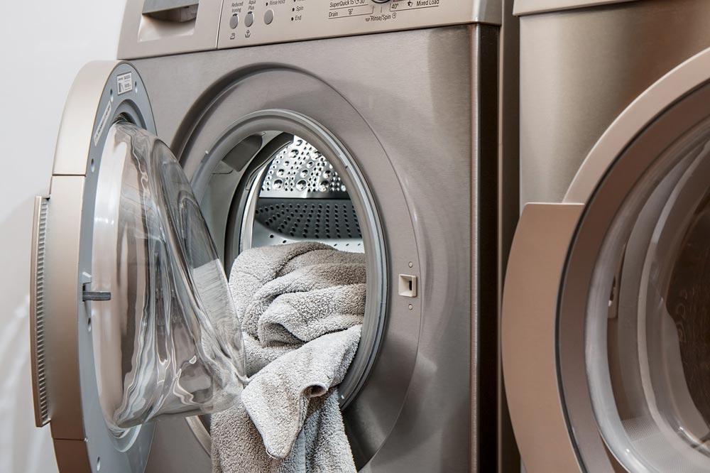 washing machine indicating moms don't get a break