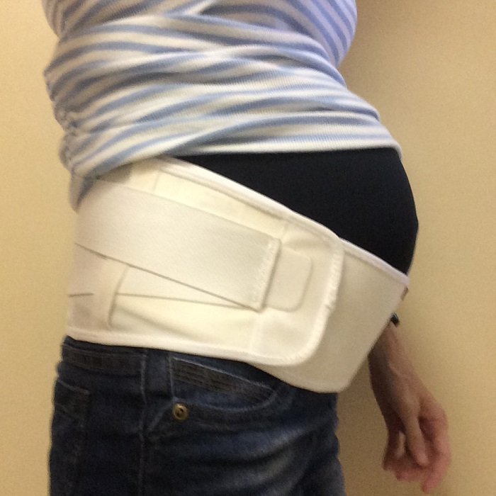 My baby bump in a belly support band for active moms. The Motherload by Body After Baby. www.sahmplus.com