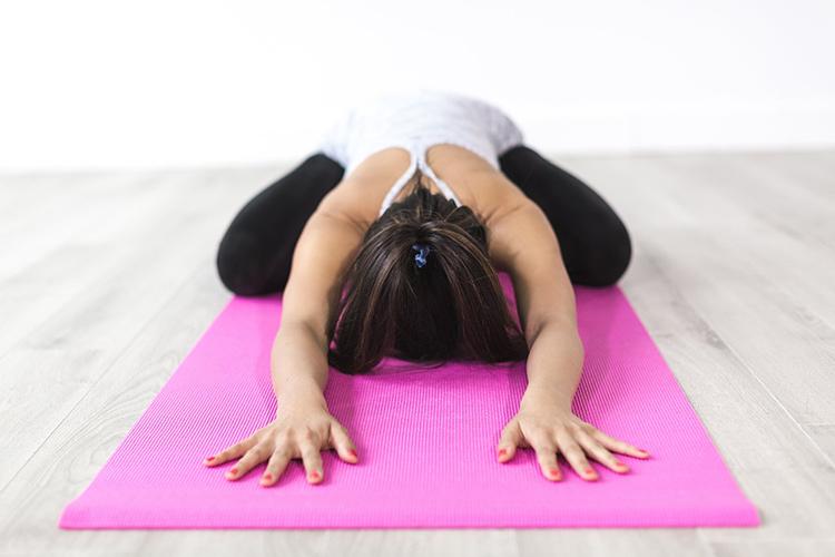 Woman doing yoga as self-care