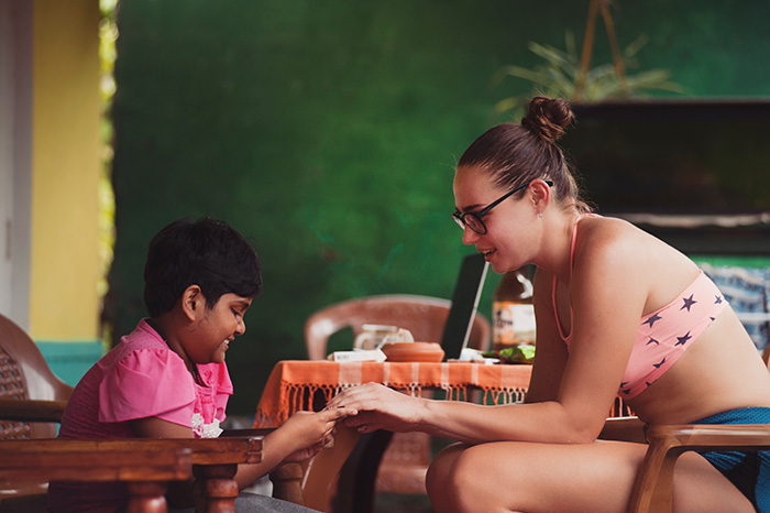 woman sitting with a child