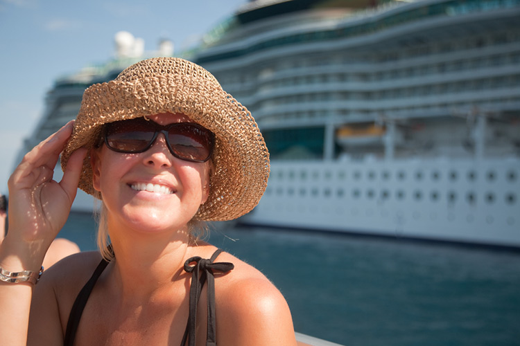 Woman with cruise ship in background. Send mom on a cruise to give her some REAL TIME OFF