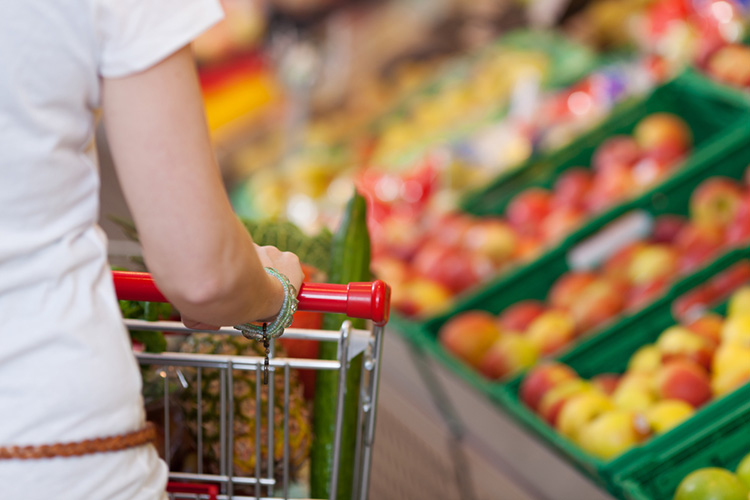Woman grocery shopping - get Shipt - great Mother's Day gift idea
