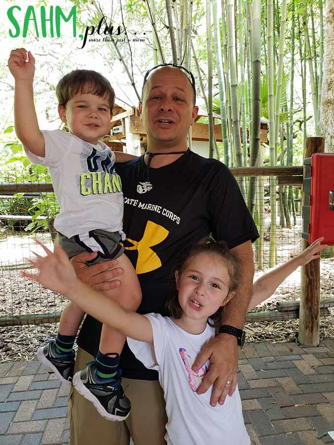 "Family waiting for the train at Zoo Tampa saying ""Yay ChooChoo"" | sahmplus.com"